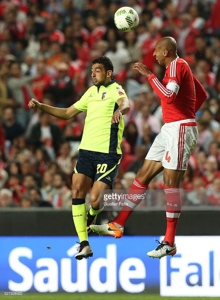 SL Benfica's defender from Brazil Luisao with SC Braga's forward Ahmaed Hassan in action during the Taca CTT match between SL Benfica and SC Braga at Estadio da Luz on May 2, 2016 in Lisbon, Portugal.