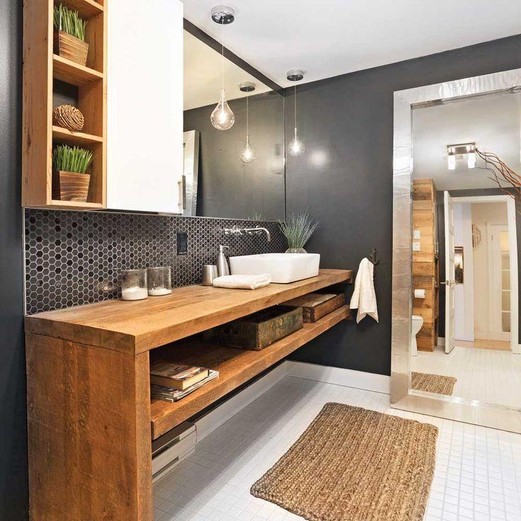 Grande tendance actuelle, le style rustique chic se transpose également dans la salle de bain et s'exprime par le mélange de matières brutes et de mobilier contemporain. Une salle de bain de ce style pourra, par exemple, marier un meuble-lavabo en thermoplastique lustré à un mur de bois de grange. Masculinité et audace sont permises avec des murs noirs et de la céramique grand format ou à motifs hexagonaux. Le contraste des finis bruts (bois, pierre) et brillants (miroirs, verre, laque) insu