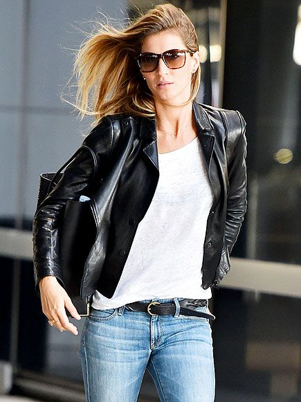 Running late? Gisele Bündchen's hair flies behind her as she hurries through JFK airport in New York City on Thursday.