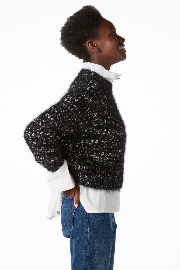 Cosy up in this fluffy, large knit sweater with just the right amount of sparkle.