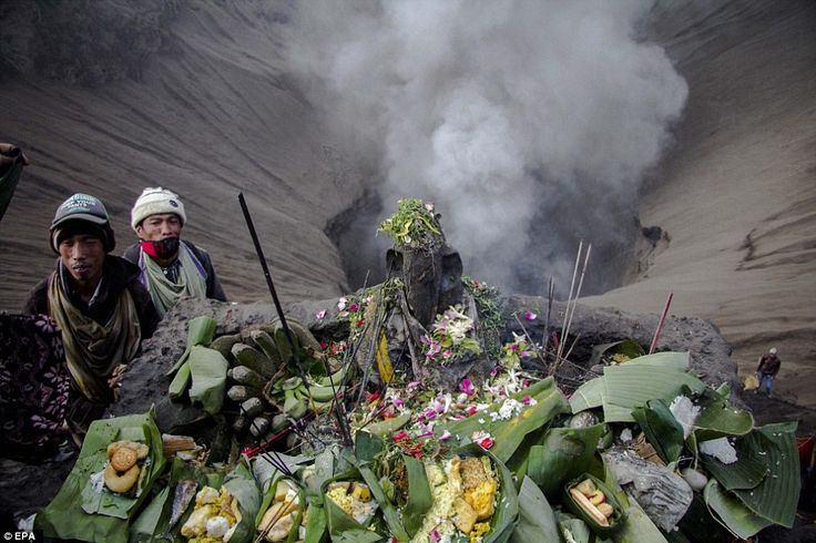thick grey smoke erupting from Mount Bromo in Probolinggo, East Java, Indonesia is a sign for the Tengger people to ready themselves for the annual Yadnya Kasada Festival.