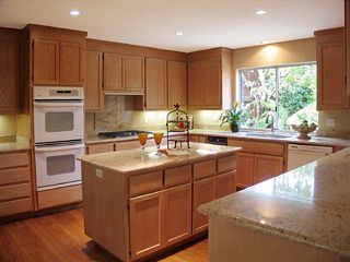 kitchens with oak cabinets and white appliances honey oak kitchen cabinets with black countertops 9858