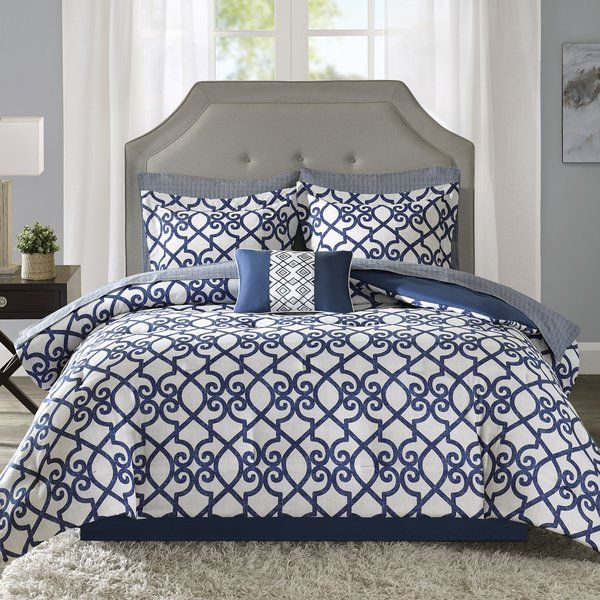 A traditional look with a touch of contemporary appeal, this lovely comforter set will instantly update the look of your bedroom. With a comforter, pillow shams, sheets, pillowcases, and a bed skirt, this set has everything you need. The scrolling trellis pattern gives this set a classic look, while the bold contrasting blue and white color palette adds a touch of modern appeal. Try making your bed with this set, then build on the traditional appeal by rolling out a simple light blue rug…