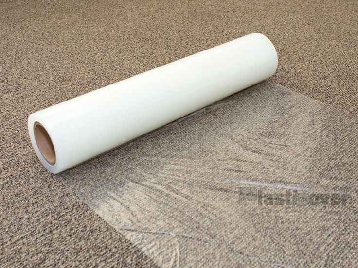 Carpet: Plastic Carpet On The Floor Is Being Rolled from What is Carpet Protector
