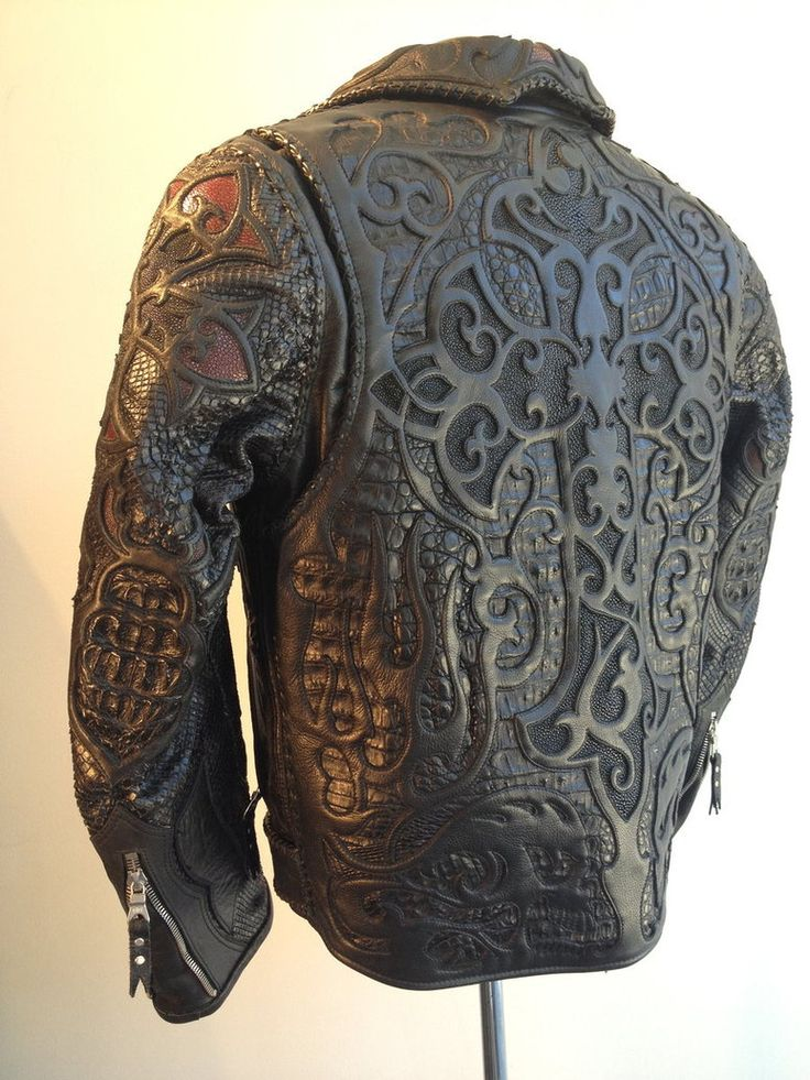 Logan Riese Leather jacket with skulls and cross by ~loganriese on deviantART