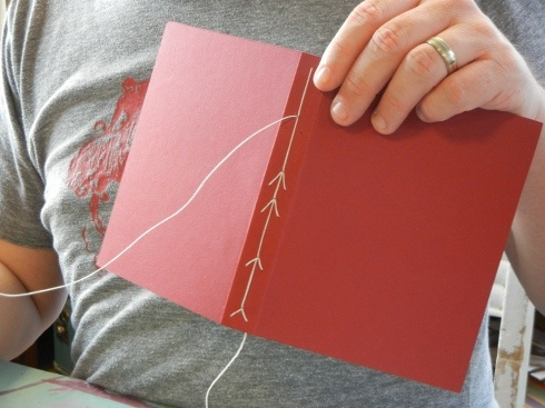 neat arrow bookbinding stitch