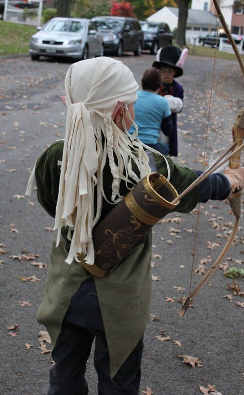 A wig that's not a wig, to give the impression of long locks without the itchy fussiness of fake hair.  Legolas costume.