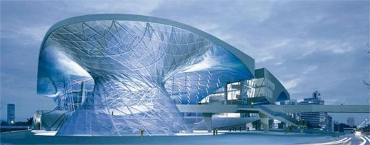 BMW Welt in Munich by architect Wolf Prix. The steel and glass building runs off solar power panels on the roof. Most of the heating and cooling is controlled through the high performance coated glass and specially designed ventilation systems. It is also just a fantastic design and looks incredible!