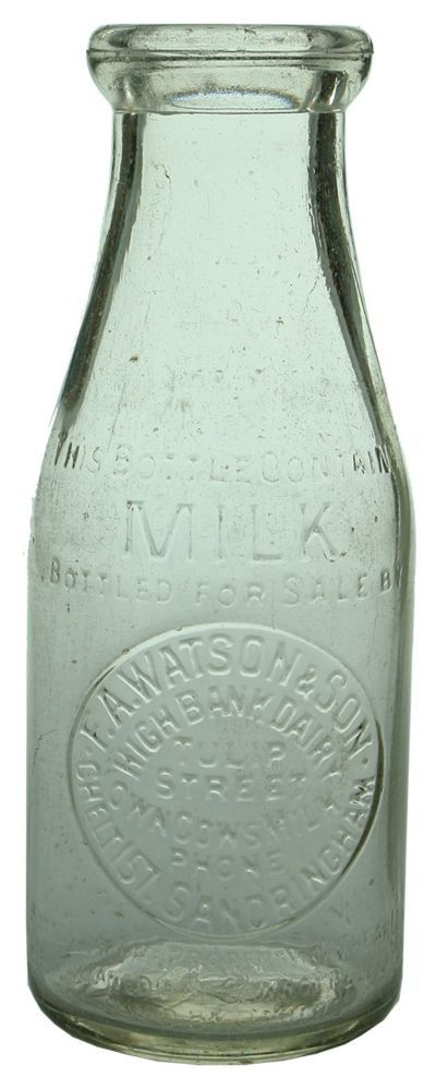 Embossing: This bottle contains / Milk / Bottled for sale by / F. A. Watson & Son / High Bank Dairy / Tulip / Street / Own Cows Milk / Phone / Chelt157. Sandringham / Bottle is the property of the above / it is loaned and cannot be legally / used by others // One Imperial Pint. Base: 333. (Victoria) Type: Household Dairy /  Era: 1940s /  Variety: Machine made, wad top.  Clear.  1 Pint. /  Height: 205 mm /  Condition: Very Good.  Shallow flake to upper front lip, another to the right lip…