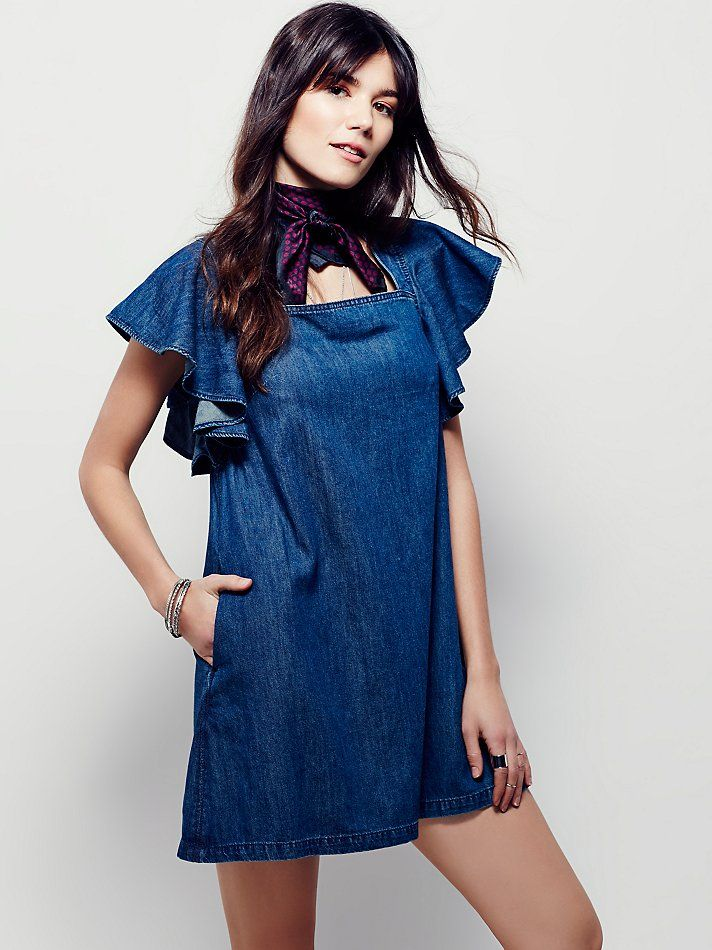 Denim Ruffle Mini Dress | Lightweight denim mini dress featuring square neckline and sweet flutter sleeves. Exposed back zip and shapeless silhouette for an easy, effortless fit. Hip pockets.