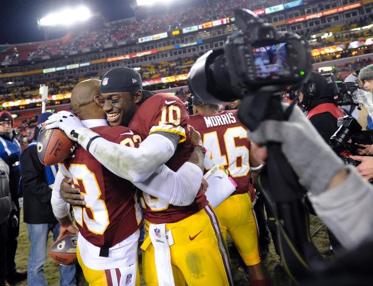 """RGIII """"I was 9 yrs old in 1999...here I stand before you 22, and the Redskins the Champions of the NFC East"""" The team makes it to the playoffs for the 1st time in 13 yrs! Next on their plate, Seattle Seahawks. Redskins 28 Cowboys 18 Week 17"""