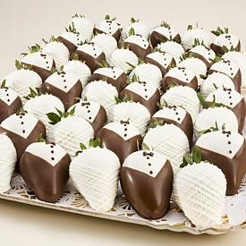 A romantic and unique wedding idea, our elegant Tuxedo Strawberries are dipped to simulate a tuxedo - complete with bow tie and buttons. The Bride Strawberries are dipped and swizzled to simulate a wedding dress complete with pink accent faux pearl dots!
