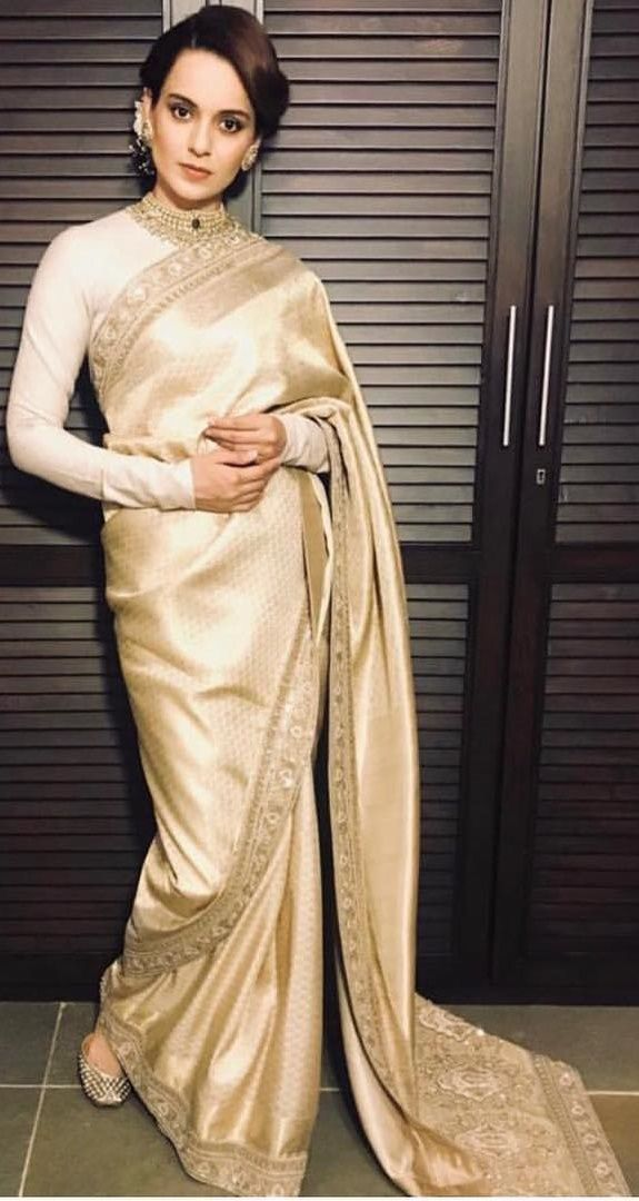 Bollywood actress Kangana Ranaut in an Ivory saree by Manish ...