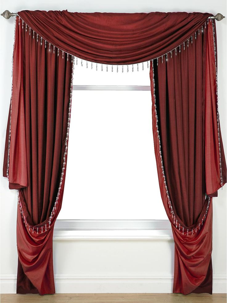Laurence Llewelyn-Bowen Grand Finale Reversible Faux-Silk Pencil Pleat Curtains in 4 colour options From the master of dramatic décor, Laurence Llewelyn-Bowen, comes the stunning Grand Finale curtain range, which will make a theatrical feature of your window.In a sumptuous faux-silk, the curtains feature an intricately beaded edging and are available in four striking colour combinations: taupe/natural, wine/red, heather/purple and charcoal/black. The slot top header means that the curtains…