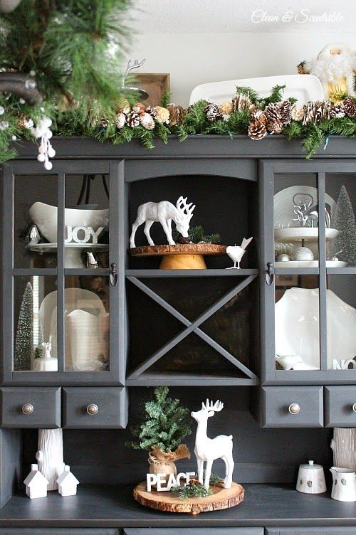 White Christmas items look good against slate-blue painted shelving.  Could paint some old decorations white for this look.  decorology