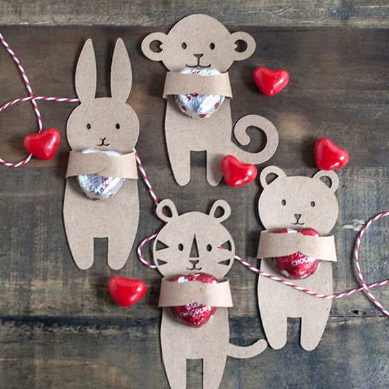 Kids Valentine's Candy Huggers-Cute Kids Valentine's hugger for your children to share with their classmates at school.-We made our set from a kraft card stock, but they are adorable in any color. Pick up these red and silver heart candies in the grocery store and use little glue dots to hold everything in place. Perfect! ~ Lia