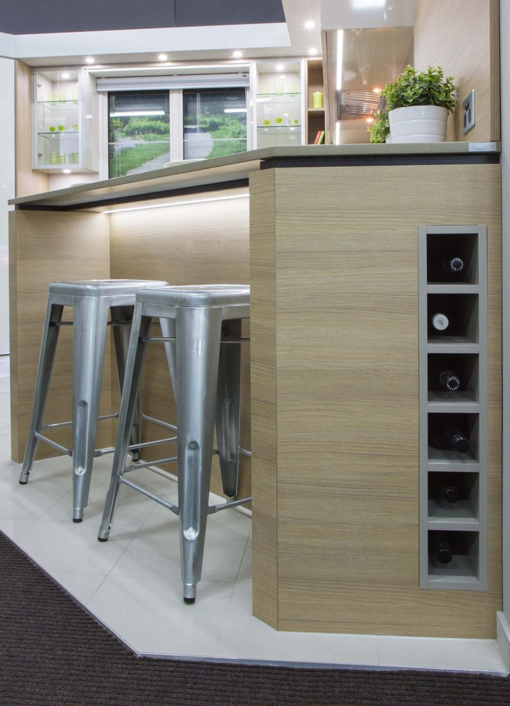 Sophisticated, handle-less kitchen in our Blackburn Showroom. www.thekitchendesigncentre.com.au @thekitchen_designcentre