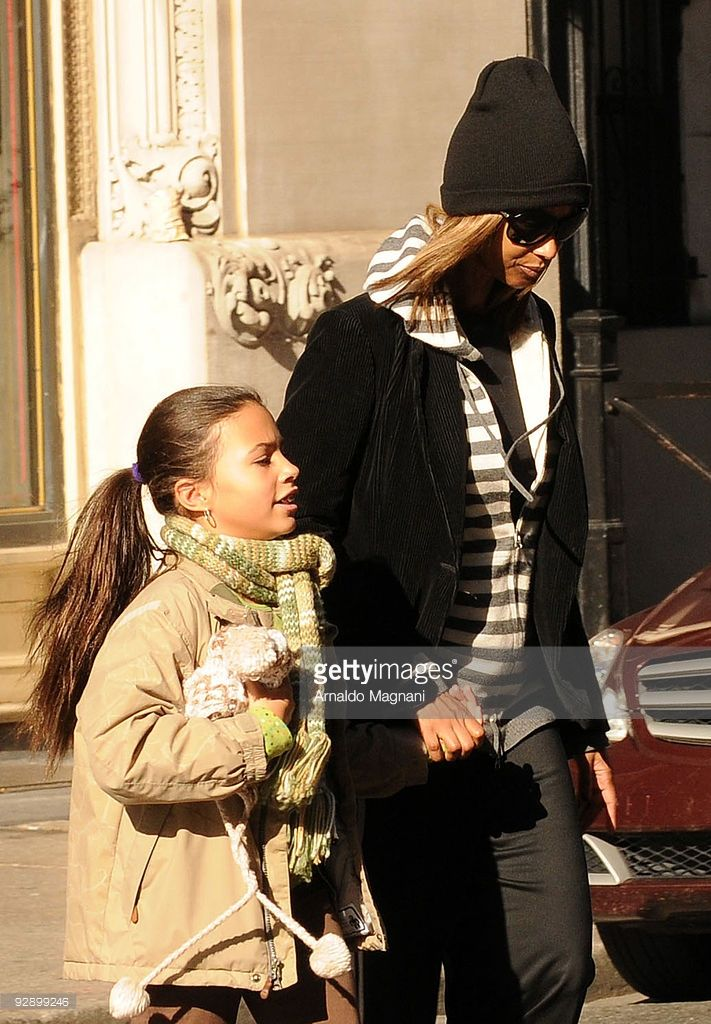 Iman and 9-year-old daugther Alexandria Bowie walk in SoHo on November 8, 2009 in New York City.
