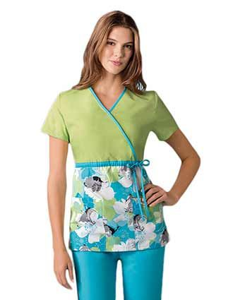 Empire waist mock wrap Dickies scrubs with Disney toons prints.