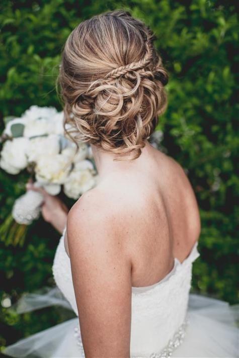 Beautiful bridal updo | David de Biasí | TheKnot.com