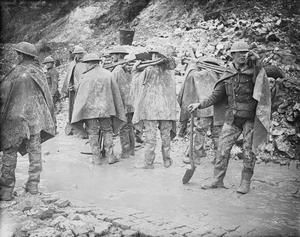 WWI, Nov 1916, Somme. Working party wearing waterproofs and trench waders, carrying shovels about to start of in the rain. Near St Pierre Divion. ©IWM