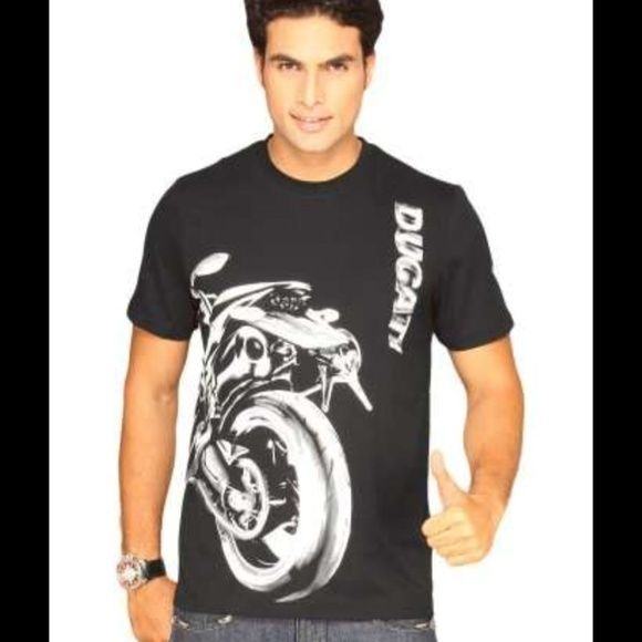 New men's white graphic T shirt Ducati bike Sz S New men's T shirt, very soft cotton, White T shirt for sale only. It fits man chest size 36 Inches who is Size S or XS  It is made by Puma for Ducati motorcycles . This T shirt is new, the tag is removed. Puma Tops Tees - Short Sleeve