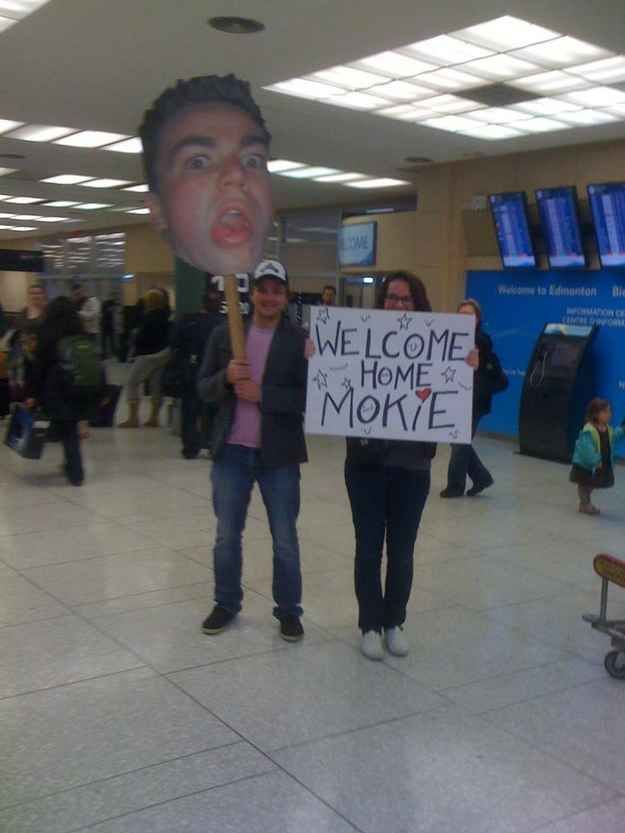The person whose family blew up their most derpy photo and put it on a giant stick: | 25 People Who Are Having A Worse Time At The Airport Than You