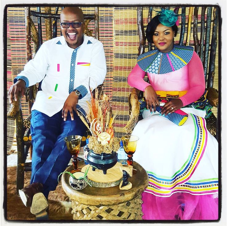 Traditional african wedding dress, african wedding gown, traditional outfits, traditional attire, wooden his and hers chairs. Zulu wedding