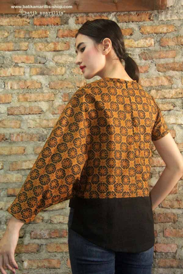 Batik Amarillis's Relax & Comfy Top Available at Batik Amarillis webstore  http://batikamarillis-shop.com Super  quirky top features Asymmetrical sleeve and hem with back zipper