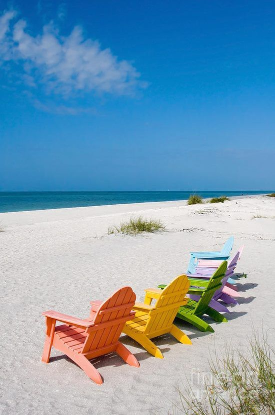 Colorful Adirondack Chairs On Beach