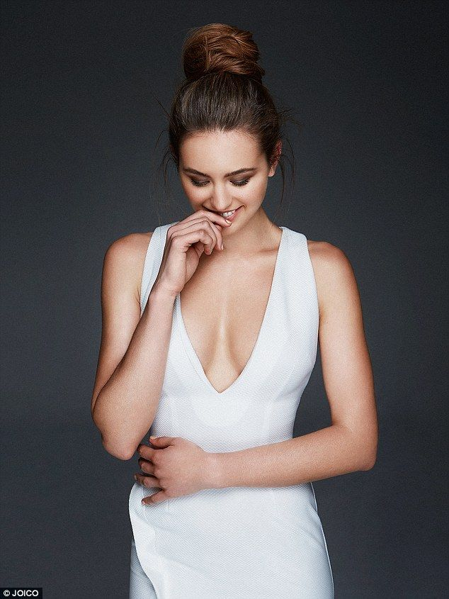 Plunging: Appearing in white, almost bridal couture, a revealing neckline leaves little to...