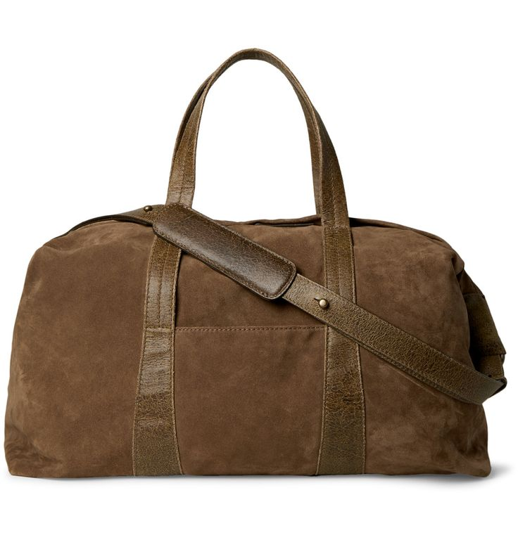 Whether you're headed away for the weekend or simply toting your gym kit to work, Maison Margiela's brown suede holdall is a stylish choice. It's sized to hold all of your essentials, including your wash bag, a few changes of clothes and spare shoes, and has an optional shoulder strap that will make dashing through the airport a breeze.