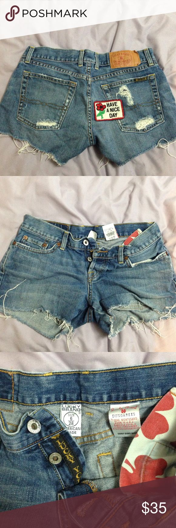 "CUTE Lucky brand daisy duke shorts with patch ""Have a nice day"" on the butt, worn once! These are SUPER cute lucky brand dungaree shorts, daisy duke style. Love these shorts! Size 28/6 get them now before they're gone!! Lucky Brand Shorts Jean Shorts"