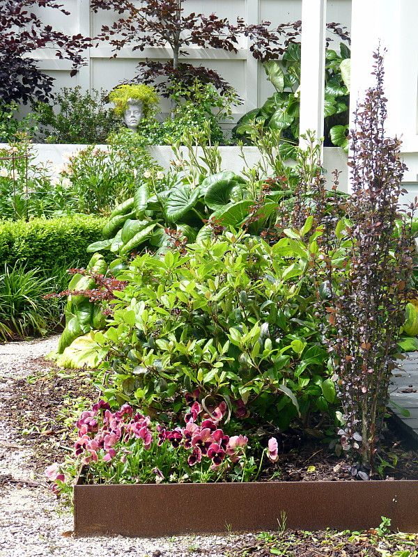 Corten edging with plants picking up the rusty tones | Beauchamp, HEDGE Garden Design & Nursery