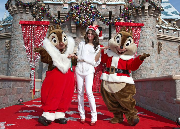 In this handout image provided by Disney, 'Wizards of Waverly Place' star Selena Gomez meets Chip and Dale during the taping of the 2010 Disney Parks Christmas Day Parade on November 7, 2010 at Disneyland in Anaheim, California. The show airs Christmas Day, at various times across the country, on ABC. (Photo by Paul Hiffmeyer/Disney via Getty Images)..