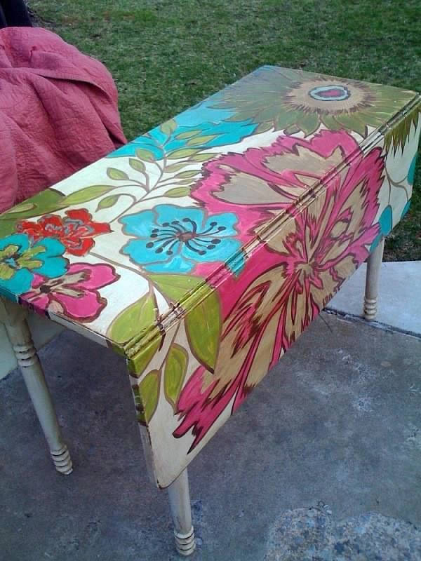 Lucky Peach Designs.      What a funky way to repurpose an old and dilapidated table.   Use marine paint and leave on your deck