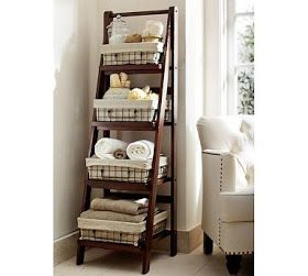 What a wonderful way to use an old ladder! If you don't have one at home, gather up a group of friend for a day of thrift store and flea market items! This inspirational photo was spotted in an old Pottery Barn Catalog.