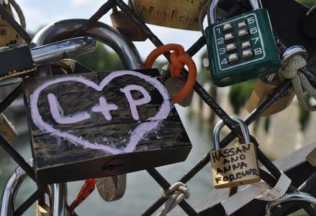 """Love-locks in Paris.   """"There are two bridges in Paris with the locks, you must be very careful which bridge you put your lock on because Pont des Arts is for your committed love, while Pont de l'Archevêché is for your lover."""" Put lock on and throw key in water."""
