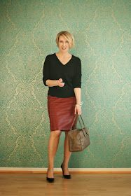 """Sexy and chic = knee length leather skirt in a sober color + """"v"""" neckline sweeter in a hue that doesn't create to much contrast with the bottom part."""