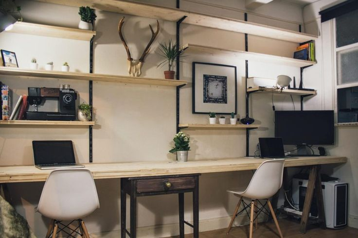 Props to this gentleman for smoothly integrating his office into his living room, and for using this workbench style table as a desk.