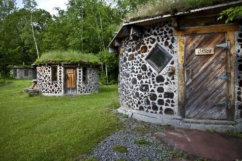 Structures at the home of Rob Roy, which was built using a method called cordwood, in West Chazy, N.Y.