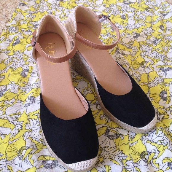 New Black and Tan espadrilles wedges Perfect summer shoe! Neutral espadrille wedges that go with any outfit. Never worn! Heel is about 3 inches with a 1 inch platform Shoes Espadrilles