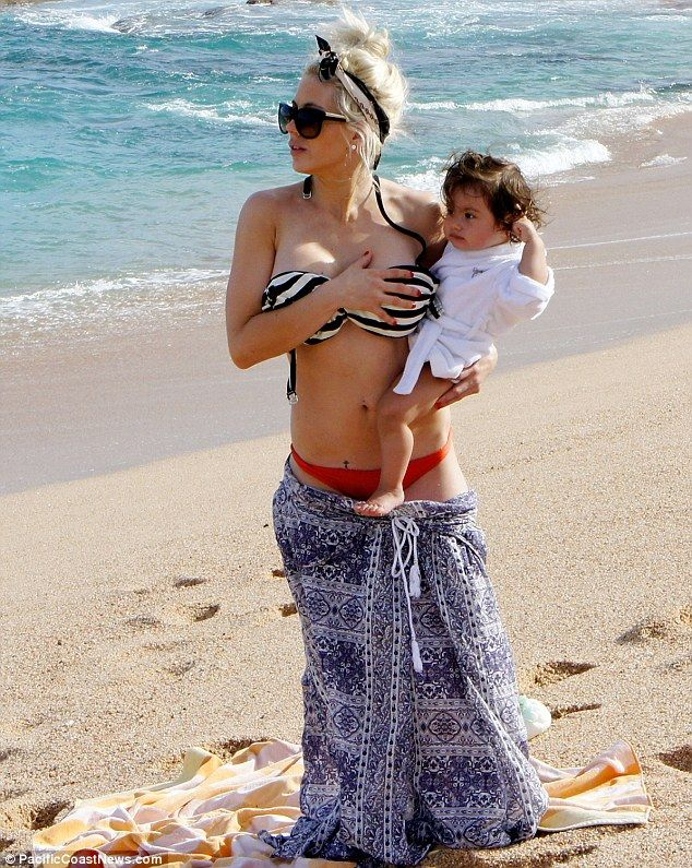 Shayne Lamas in bikini while frolicking on beach with baby daughter in Cabo San Lucas, Mexico, April 2013.
