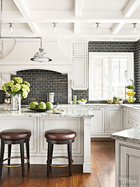 Realize the untappedpotential of kitchen ceilings. For the often overlooked area overhead, shallow coffers shake up small spaces, while moldings complementing the shape of an island or work space below can help define larger kitchens./