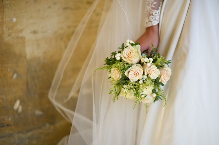 A lovely hand tied bouquet of peach tale roses and hypericum berries, Blenheim Palace
