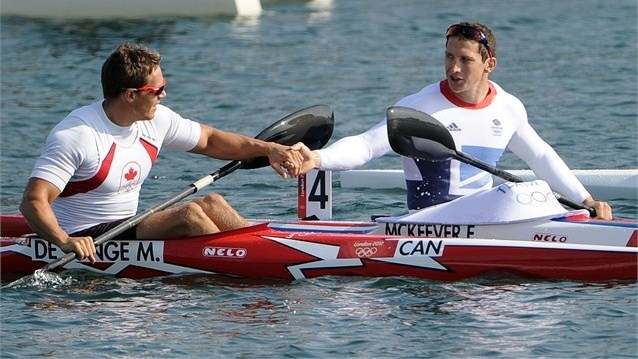 Bronze medallist Mark de Jonge of Canada (L) congratulates Ed McKeever of Great Britain after the men's Kayak Single (K1) 200m Canoe Sprint on Day 15.