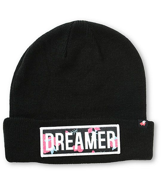 """This tight ribbed knit beanie is finished with a brand tag on the hem and a floral print """"Dreamer"""" patch at the cuff for a trendy and comfortable look."""