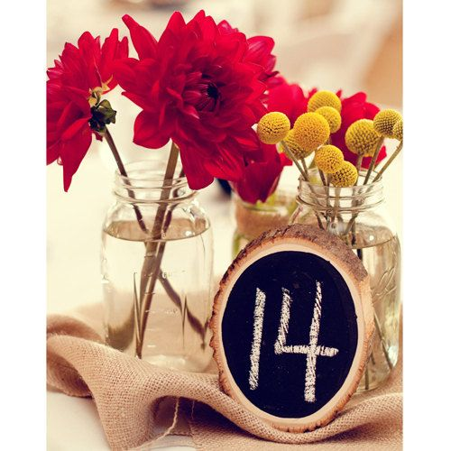 Tree Slice Chalkboard Table Numbers. Whether your theme is woodland, country, rustic, or natural, these darling chalkboard tree slice table numbers are an elegant personalized touch to any event.