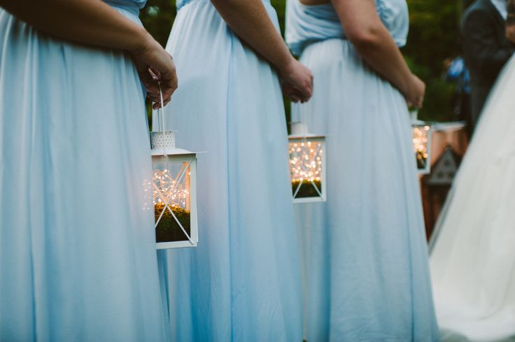 Maybe each bridesmaid could walk down the isle with a lighted lantern and bouquet, or just the lantern. Can you imagine the effect, in combination with all the other twinkling lights we'll strew about...???!!! So romantic. Especially if we do it at dusk.