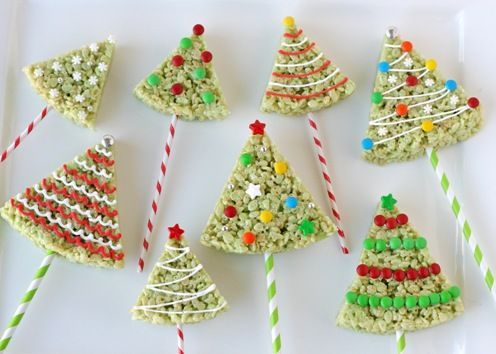 Rice Krispies Treats Christmas Trees - I used pretzel sticks for the trunks and frosted with green icing before decorating - yum!